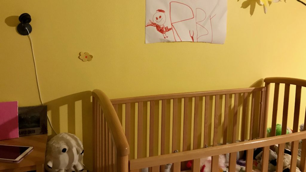 The Nest Cam mounted to a wall above a crib