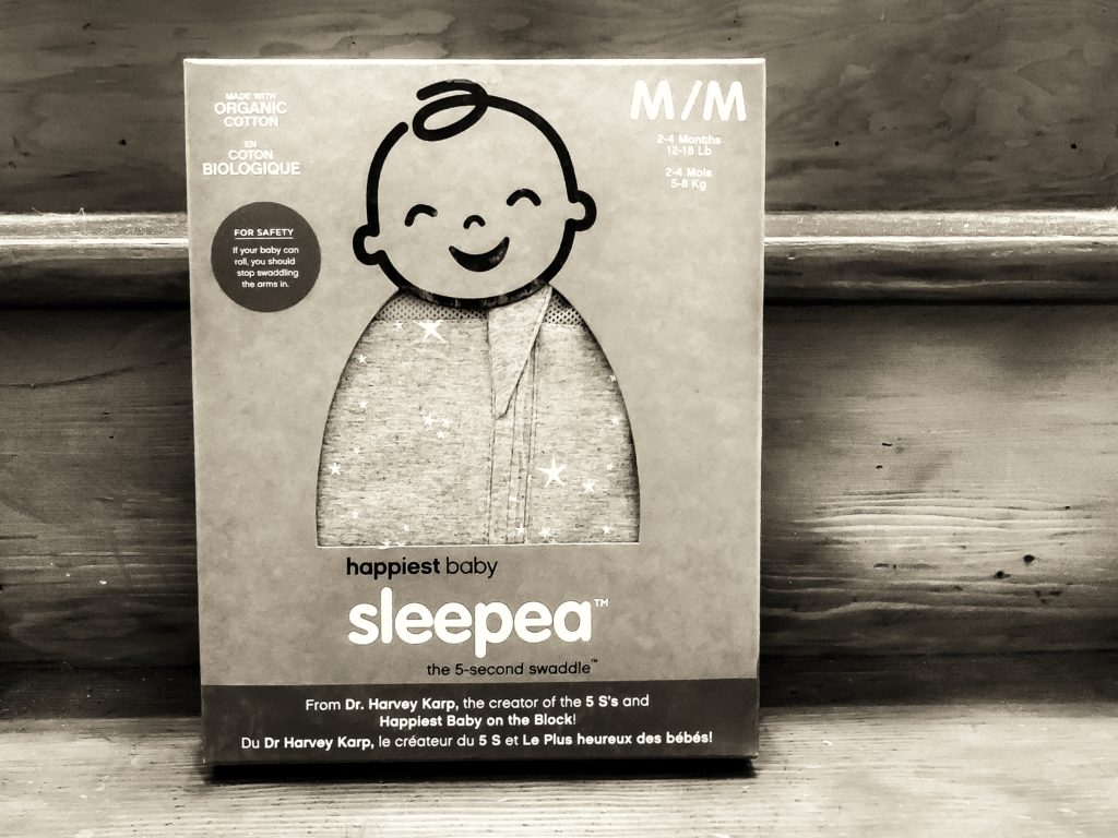 A medium Sleepea swaddle from Happiest Baby in the box