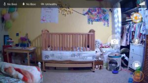 A screenshot from the iBaby Care app displaying a crib in a kid's room