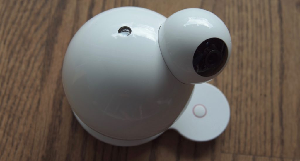 Looking down at the iBaby M7 baby monitor sitting on a hardwoord floor