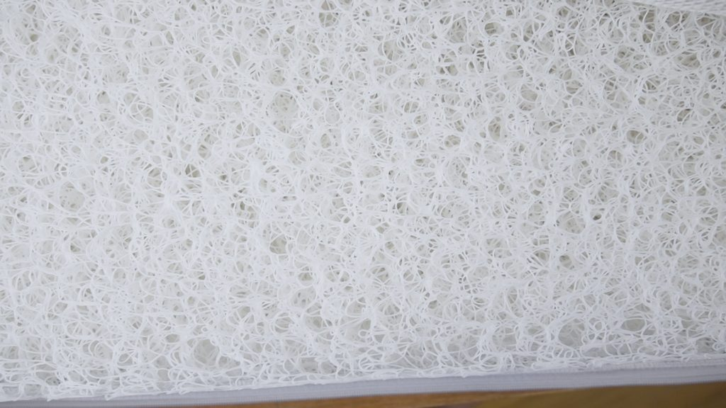 A top down shot of the Newton baby crib mattress without the cover